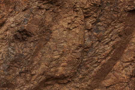 hardwearing: Dark red stone with lots of small cracks Stock Photo