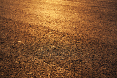 hardwearing: Paved road in the rays of the evening setting sun Stock Photo