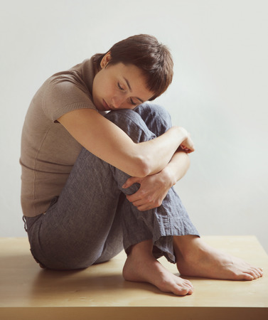hugging knees: Beautiful woman sitting and sleeping, hugging his knees