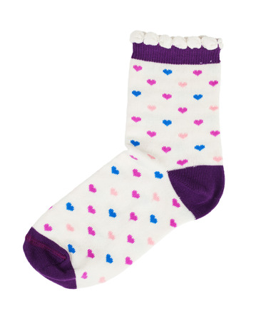 Knitted socks with red hearts on the surface photo