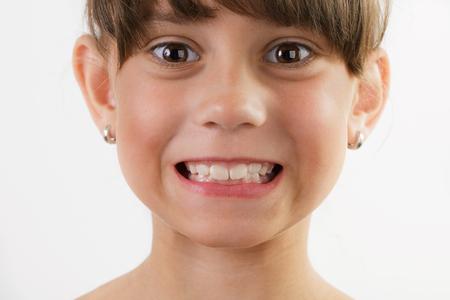 blithe: Cute cheerful little girl shows us the teeth Stock Photo