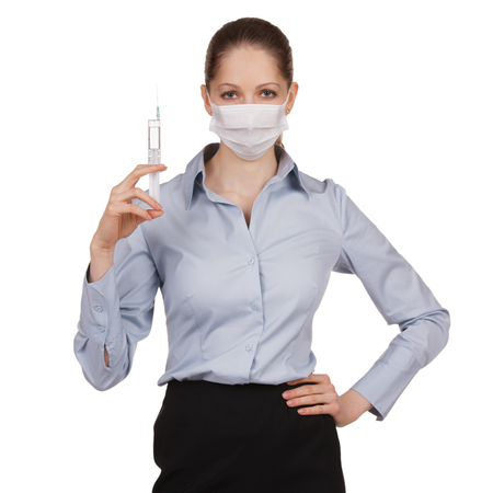 Strict woman in medical mask with syringe