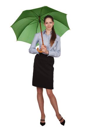 Pretty happy girl with big green umbrella