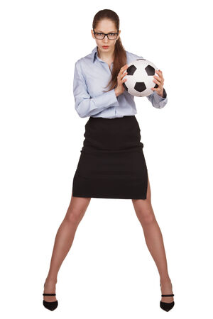 volition: Young woman with a soccer Ball on white background