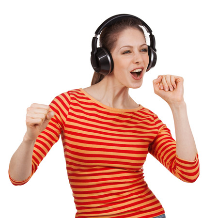 gaily: Cheerful girl with headphones dancing to music