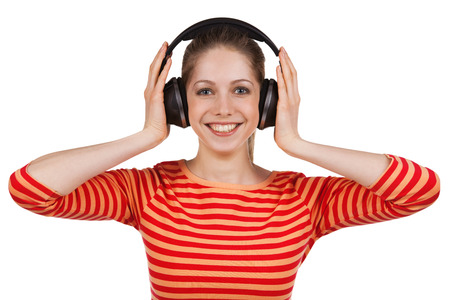 gaily: Smiling girl listens to music on headphones Stock Photo