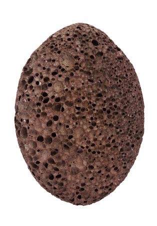 firmeza: Pedazo de p�mez de color marr�n sobre un fondo blanco