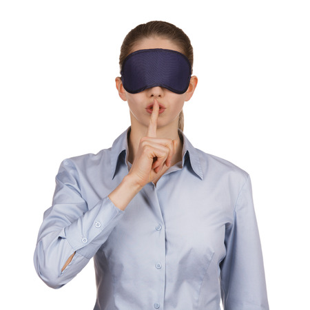 Pretty young woman blindfolded calls for silence