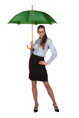 Beautiful stylish woman standing under a big green umbrella Stock Photo