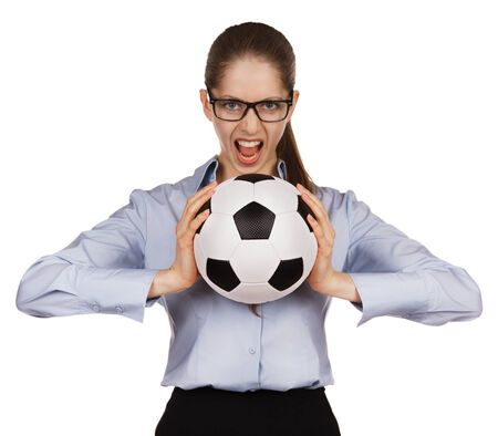 Aggressive girl with a soccer Ball in hands photo