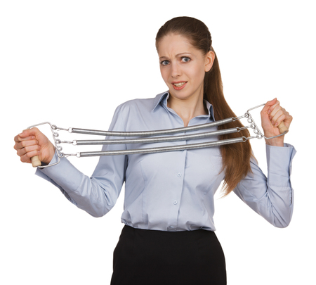 volition: Young woman trying to stretch metal expander