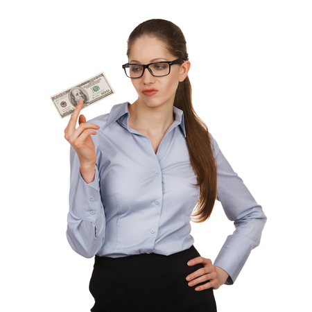 boodle: Young woman holding a hundred dollar bill disparagingly Stock Photo