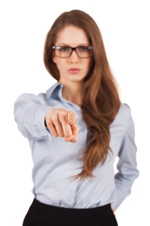 principled: Serious girl in glasses shows forefinger forward