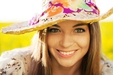 blithe: Happy young woman in a wicker hat Stock Photo