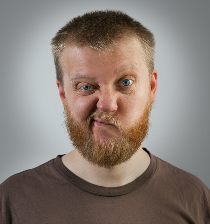 discontent: Bearded man with an expression of discontent on his face Stock Photo