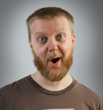 Bearded man with an expression of surprise on his face Imagens