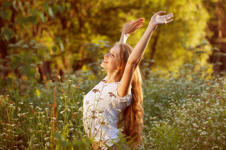 blithe: Beautiful happy young woman among the wildflowers Stock Photo