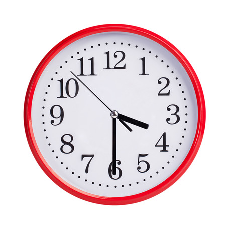clockwise: Half of the fourth on a red round clock face Stock Photo
