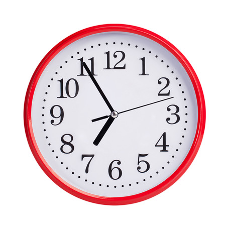 clockwise: Five to seven on a red round clock face