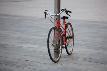larceny: Old bicycle bound metal chain in town