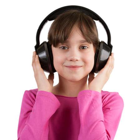 blithe: Happy girl listening to music on headphones Stock Photo