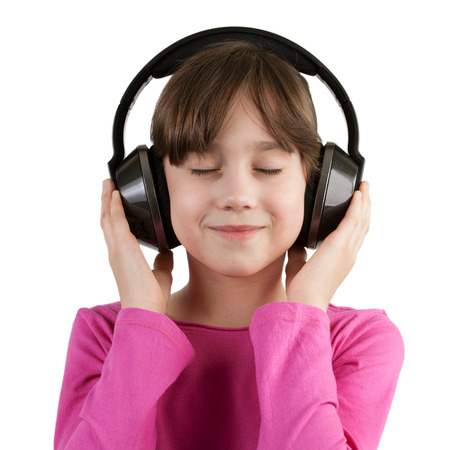 blithe: Happy little girl having fun listening to music on headphones