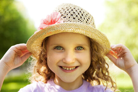 blithe: Happy smiling little girl in a straw hat