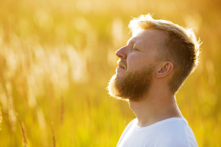 blessedness: Happy man with eyes closed dreaming about something Stock Photo