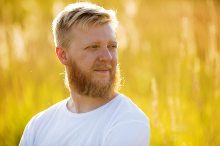 blessedness: Blond bearded man looks into the distance Stock Photo