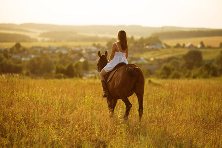 blessedness: Girl in white dress sitting on a horse