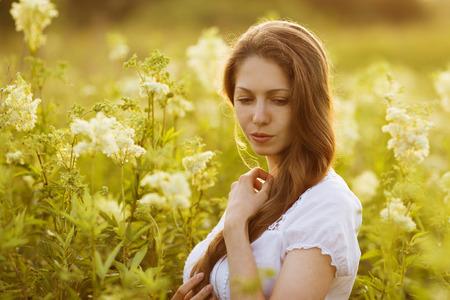 beatitude: Beautiful thoughtful young woman of high wildflowers