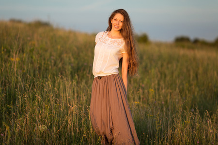 beatitude: Beautiful woman in a skirt and white blouse