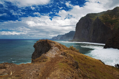 Landscape with mountains, the Atlantic Ocean and cloudy sky photo