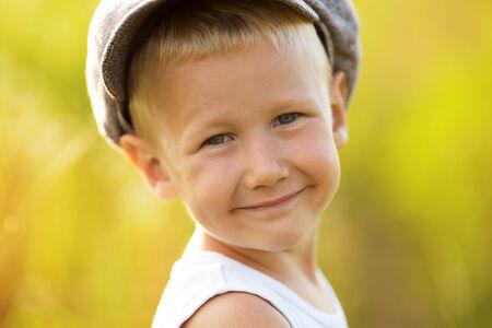honey blonde: Happy smiling little boy in a woolen cap