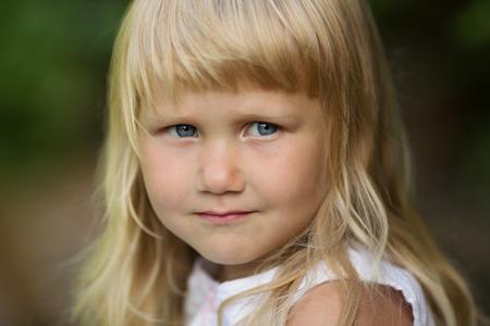 honey blonde: Portrait of a little cute blonde girl