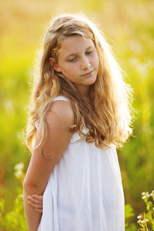 beatitude: Beautiful lovely girl in a dress of wildflowers Stock Photo