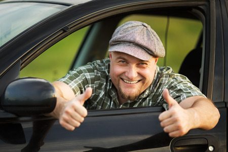 Happy driver shows that everything is fine photo