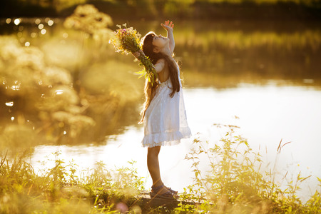 beatitude: Happy enthusiastic girl with a bouquet of flowers