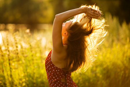 beatitude: Happy woman with her hair in the evening sun