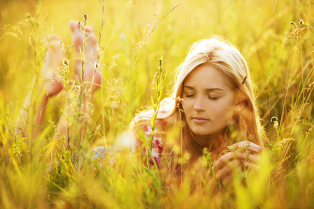 luxuriate: Beautiful young woman with closed eyes in the grass