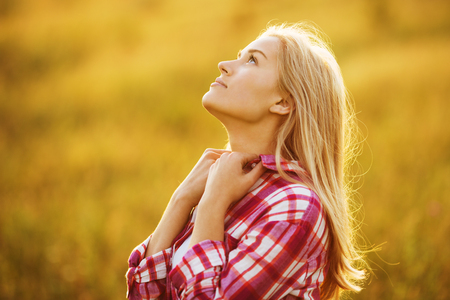 luxuriate: Happy beautiful blonde girl dreaming about something Stock Photo