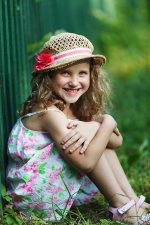 blessedness: Cute happy little girl in a straw hat