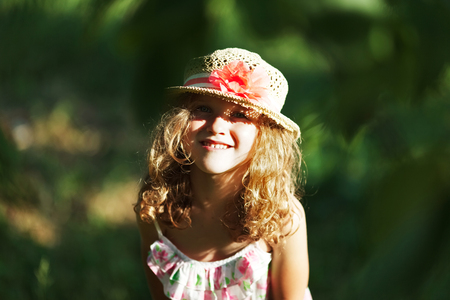 blessedness: Cute happy little girl in a hat