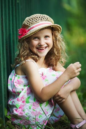 blessedness: Happy little girl in a hat cheerfully laughs