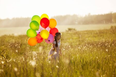 blessedness: Little girl with a bunch of balloons
