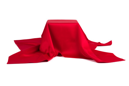 to conceal: Subject covered with red cloth on a white background