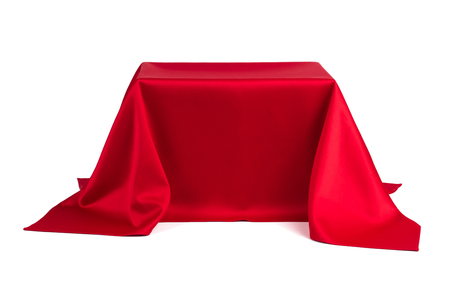Something covered with red cloth on a white background