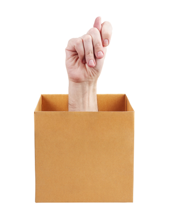 mockery: Human hand sticking out of a cardboard box Stock Photo