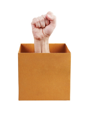 admonition: Human fist leaned out of the carton box Stock Photo