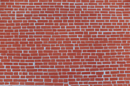 plurality: Brick wall, built of a plurality of bricks